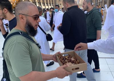 Giving away food and dates in Front of Haram in Makkah
